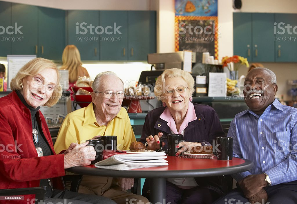 Senior adults drinking coffee in a cafe stock photo