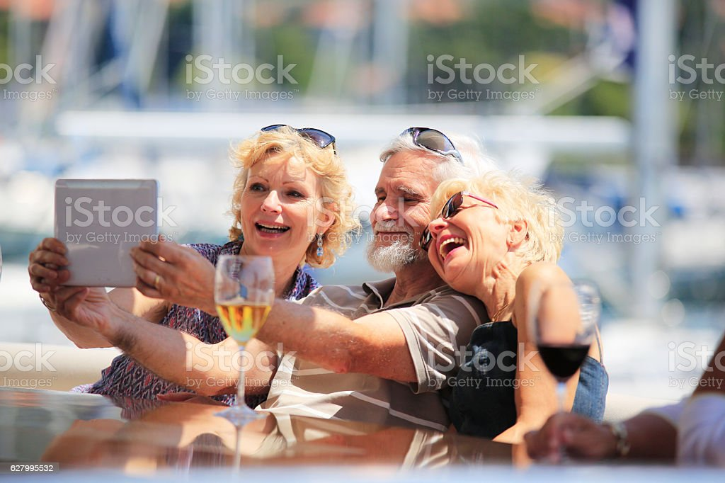 Senior adults having fun while taking selfie picture stock photo