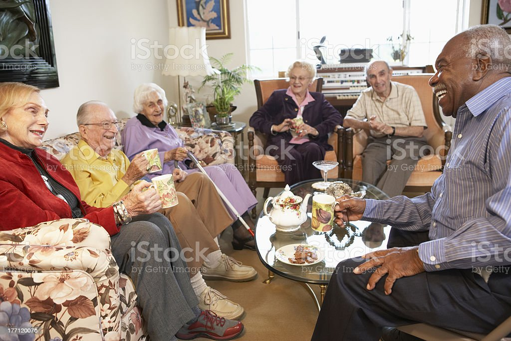 Senior adults having morning tea together royalty-free stock photo