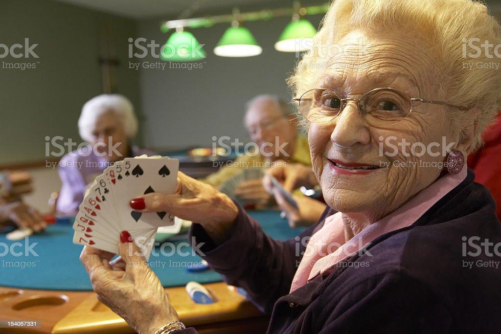 Senior adults playing bridge royalty-free stock photo