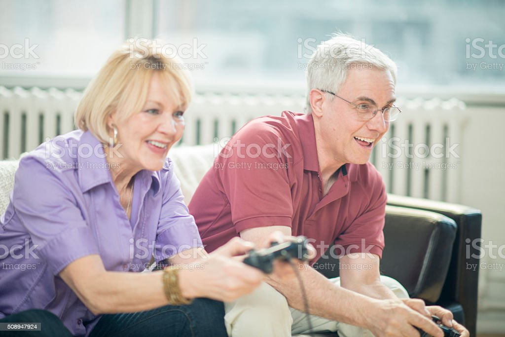 Senior Adults Playing Video Games stock photo