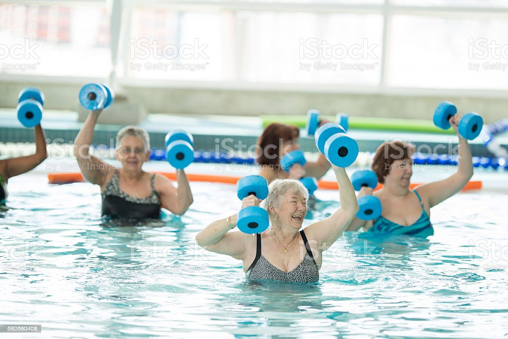 Senior Adults Taking a Water Aerobics Class at the Pool stock photo