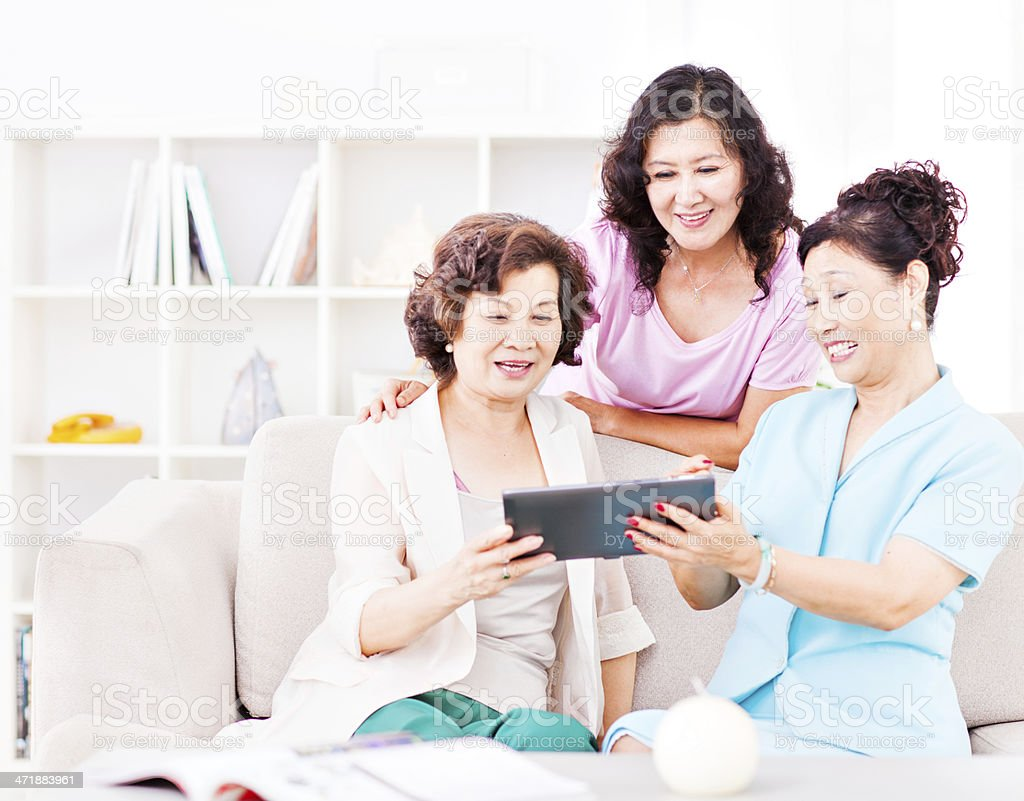 Senior adults with digital tablet royalty-free stock photo