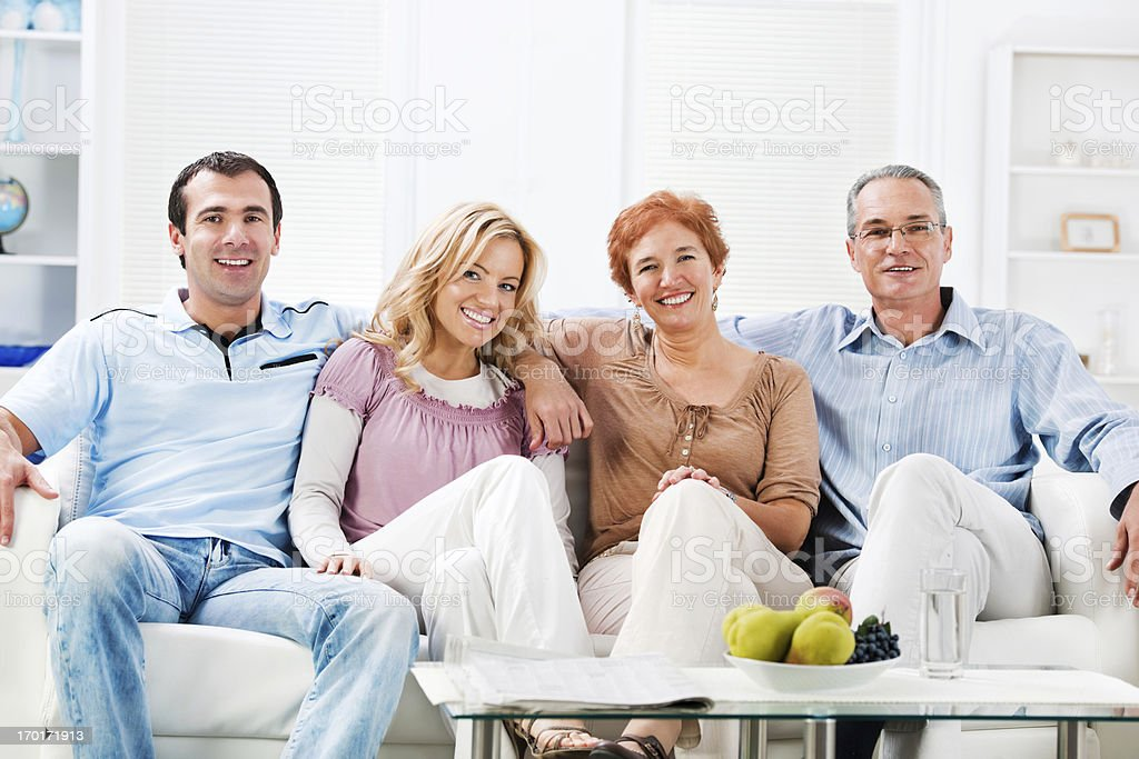 Senior adults with their adult children at home. royalty-free stock photo