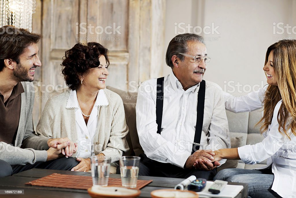 Senior adults with their adult children. royalty-free stock photo