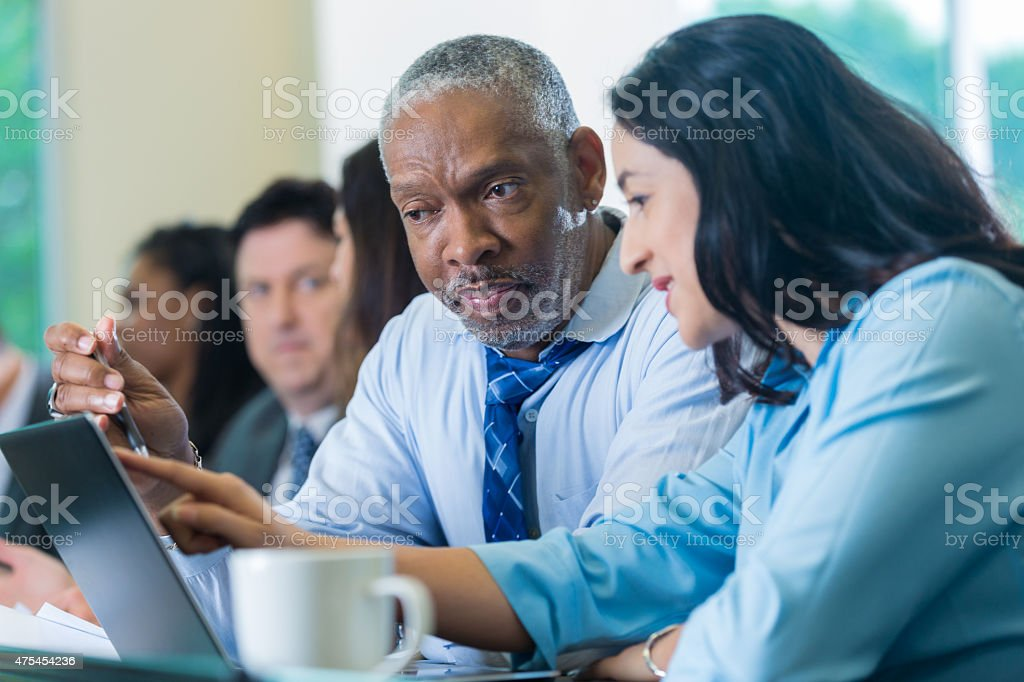 Senior African American businessman in conference or business training seminar stock photo