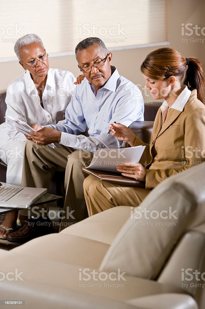 Senior African American couple meeting with financial adviser royalty-free stock photo