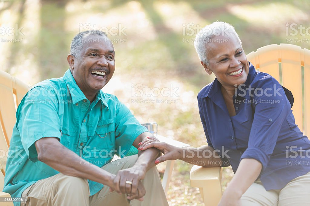 Senior African American couple on adirondack chairs stock photo