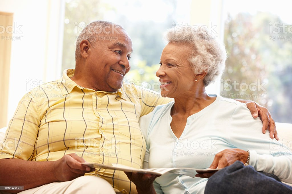 Senior African American couple reading stock photo