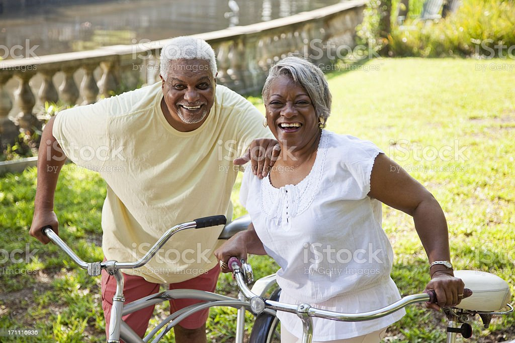 Senior African American couple riding bicycles royalty-free stock photo