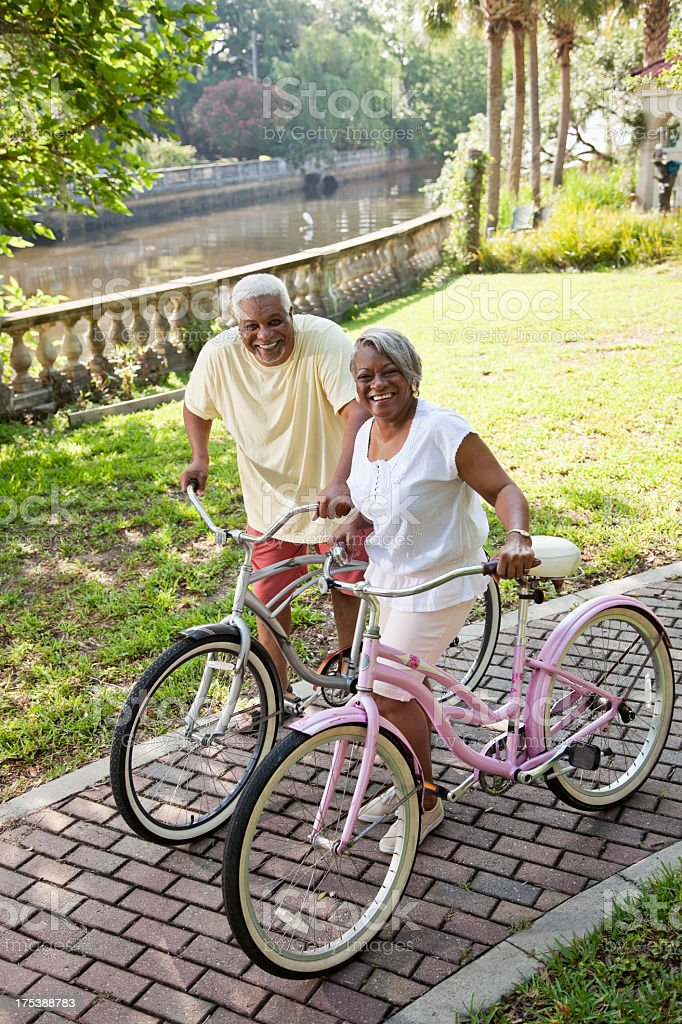 Senior African American couple riding bicycles stock photo