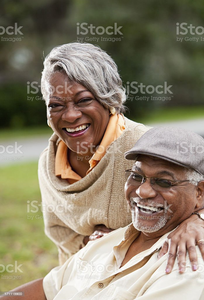 Senior African American couple smiling outdoors stock photo