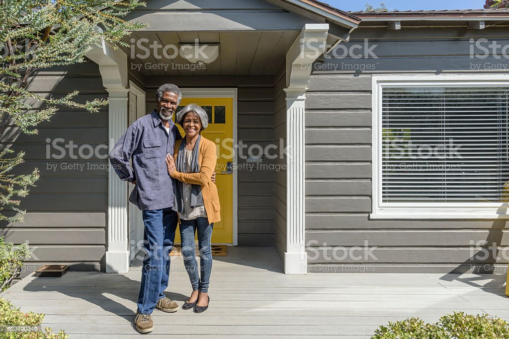 Senior African American couple smiling outside their home stock photo
