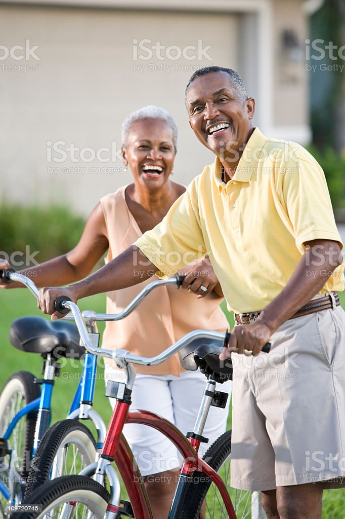 Senior African American couple with bicycles stock photo