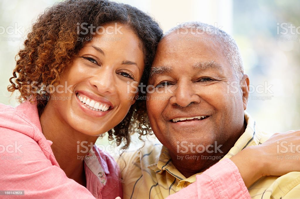 Senior African American man and granddaughter stock photo