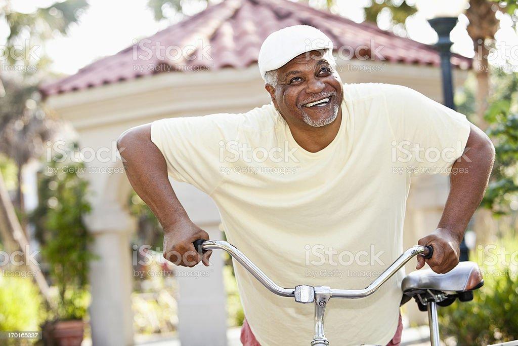 Senior African American man riding bicycle stock photo