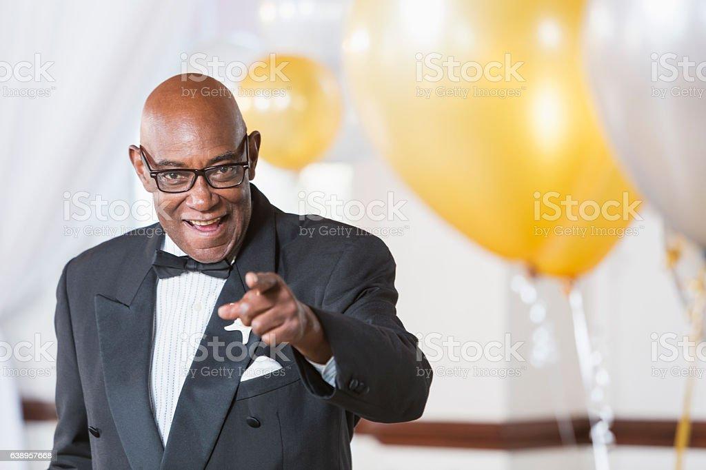 Senior African American man wearing a tuxedo stock photo