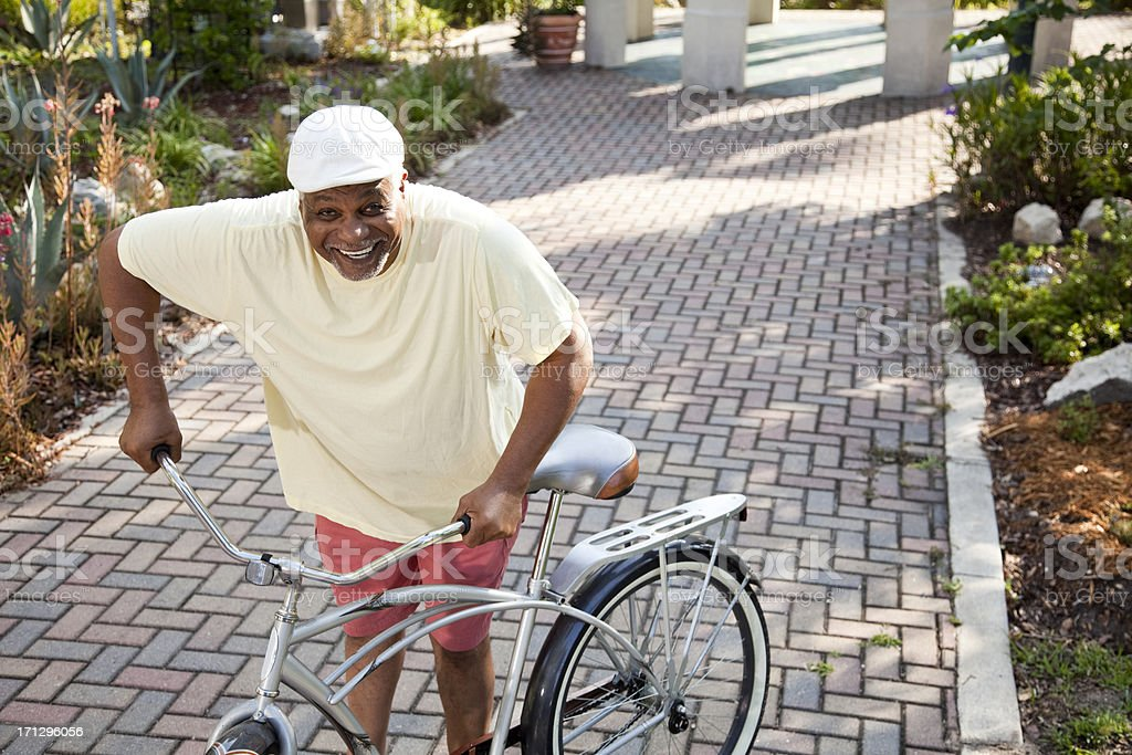 Senior African American man with bicycle stock photo
