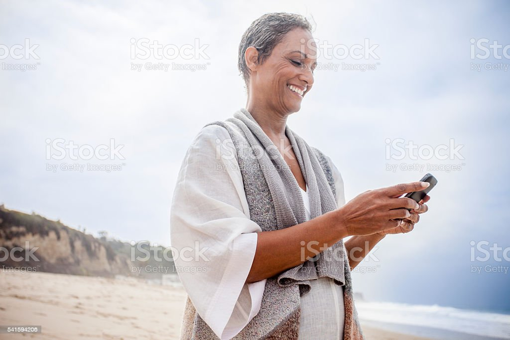Senior African American Woman Checking Smartphone stock photo