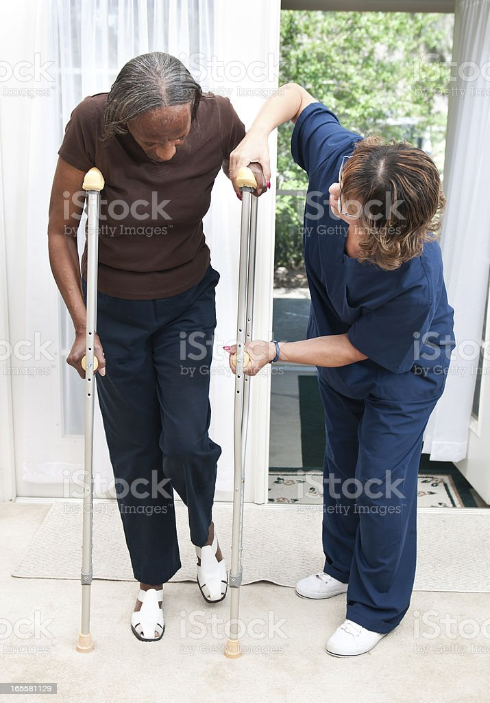 Senior African American Woman getting help with Crutches royalty-free stock photo