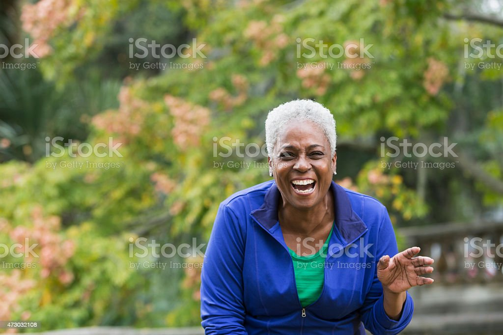 Senior African American woman laughing stock photo