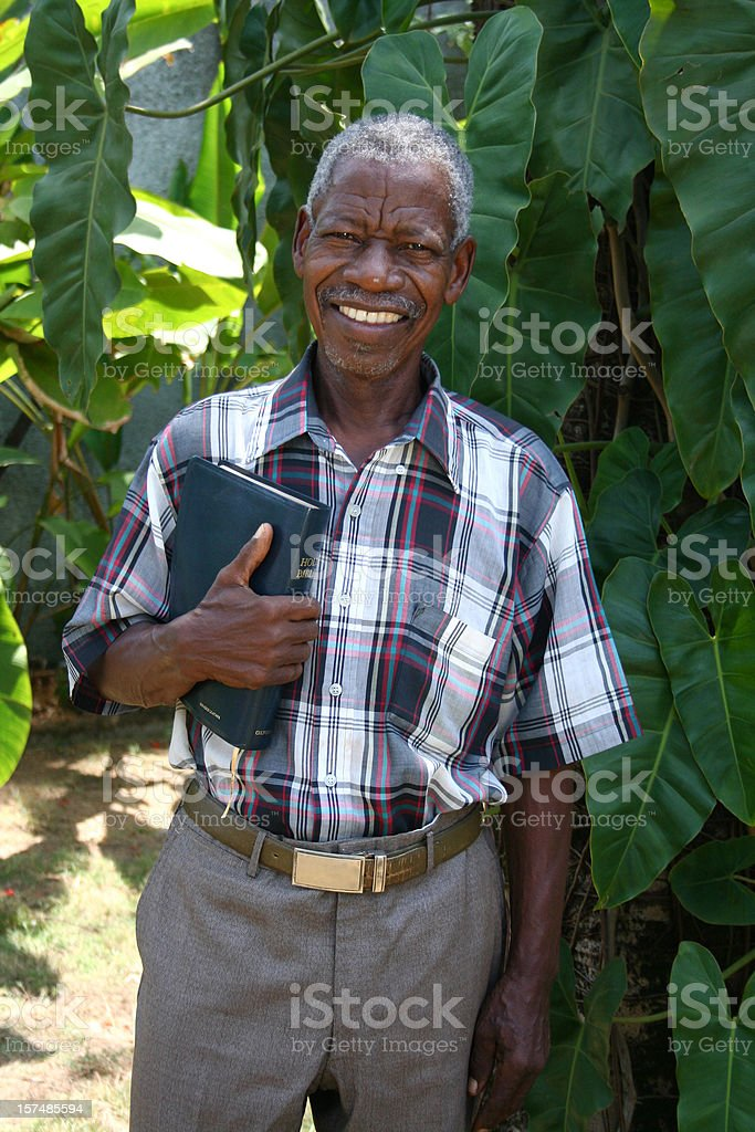 Senior African Pastor with Bible royalty-free stock photo
