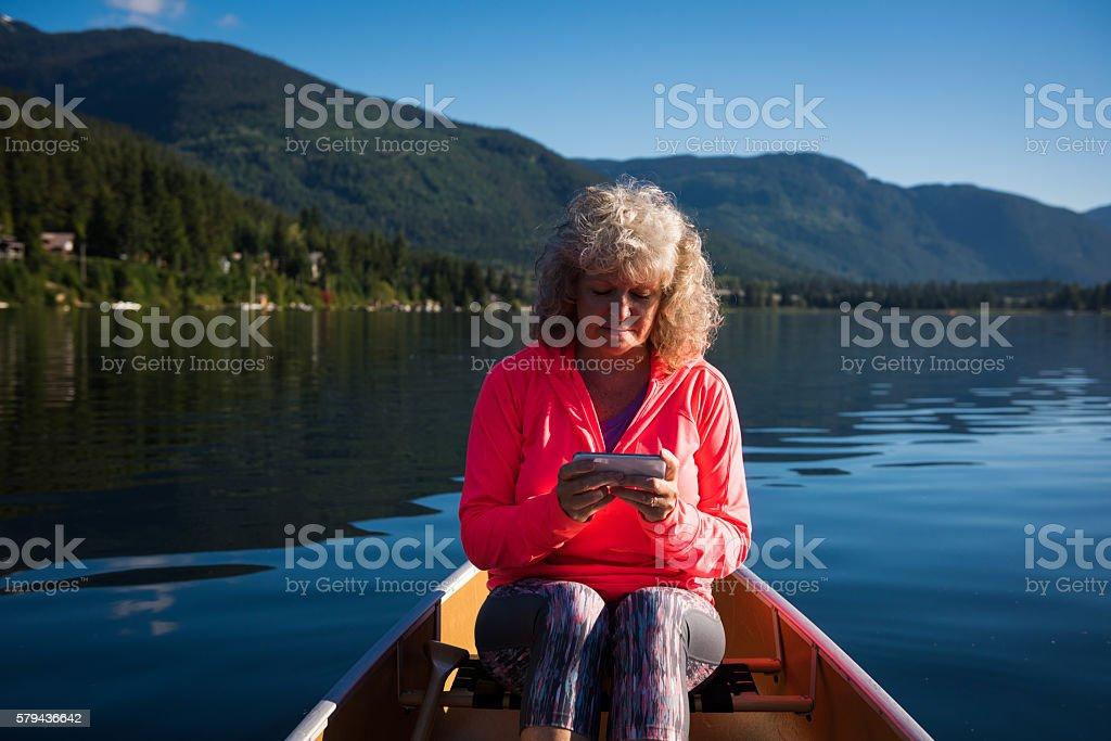Senior aged woman using a smart phone stock photo