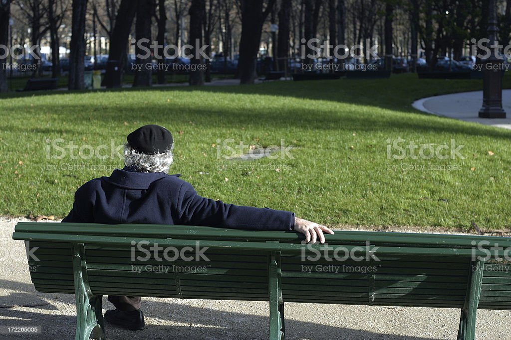 senior alone in paris royalty-free stock photo