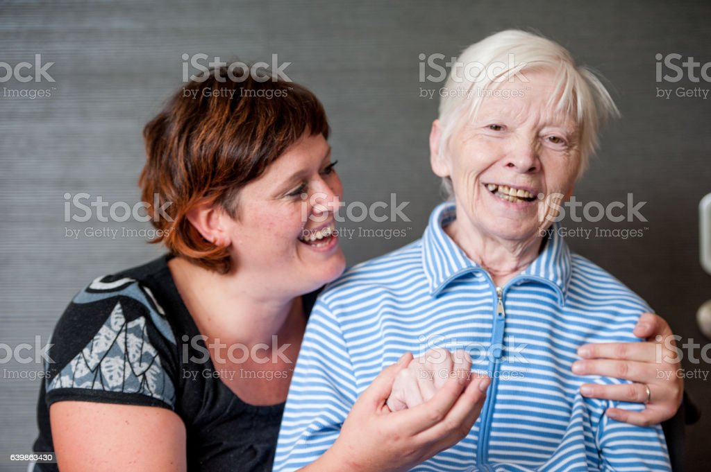 Senior and Caregiver Portrait in the Retirement Home stock photo