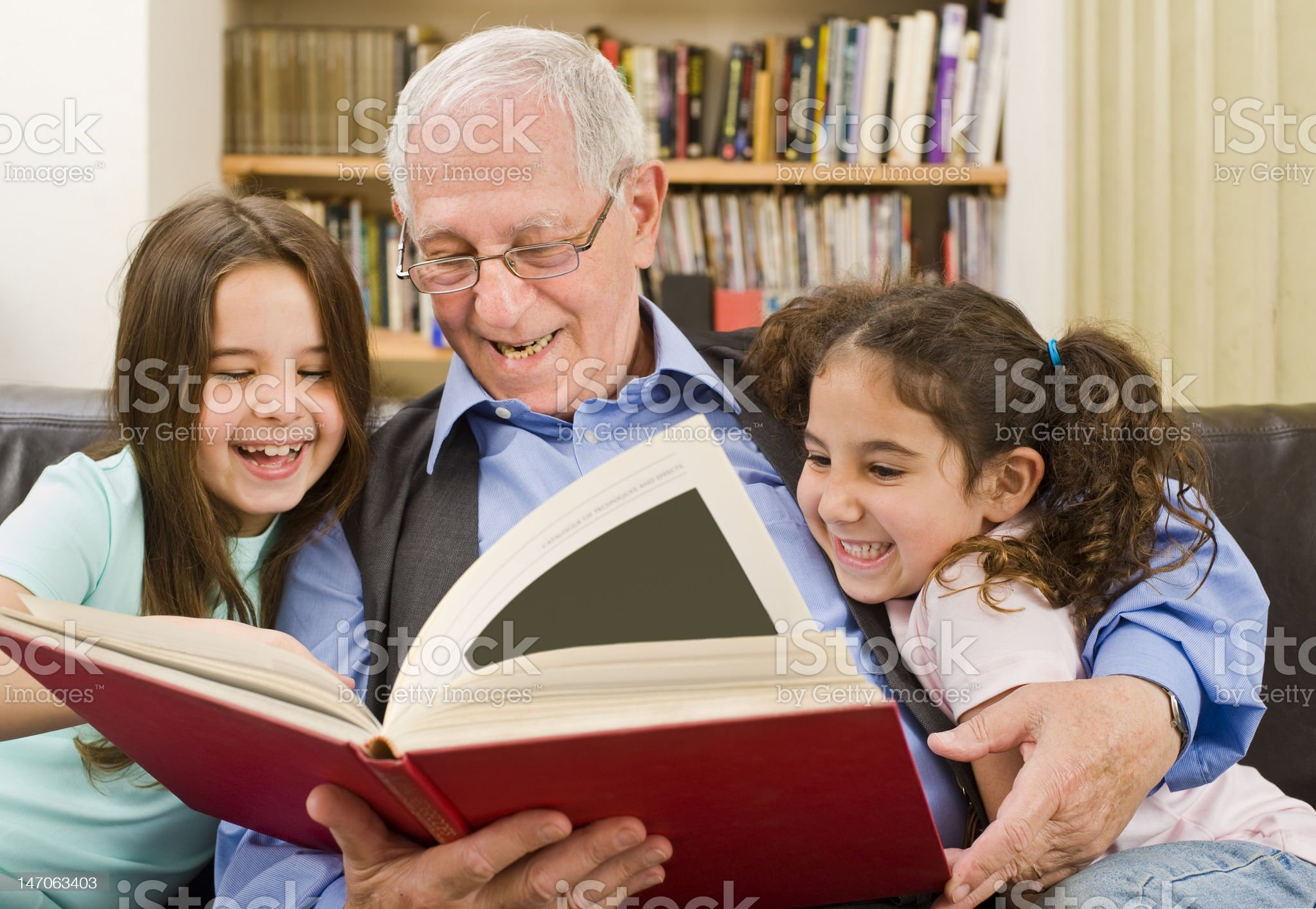 senior and children reading royalty-free stock photo