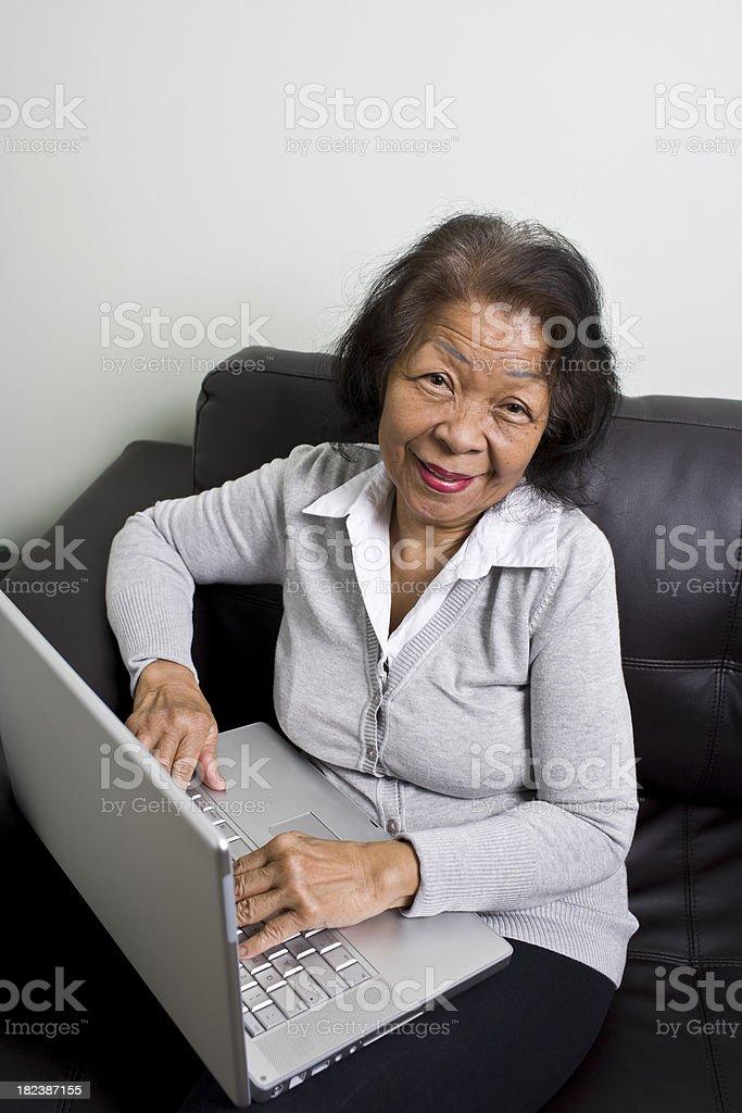Senior and Laptop Computer royalty-free stock photo