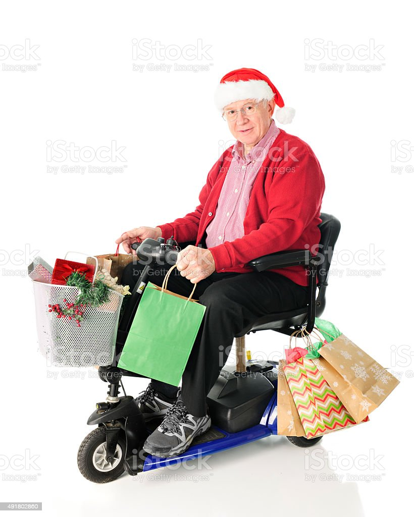 Senior and Scooter Loaded with Gifts stock photo