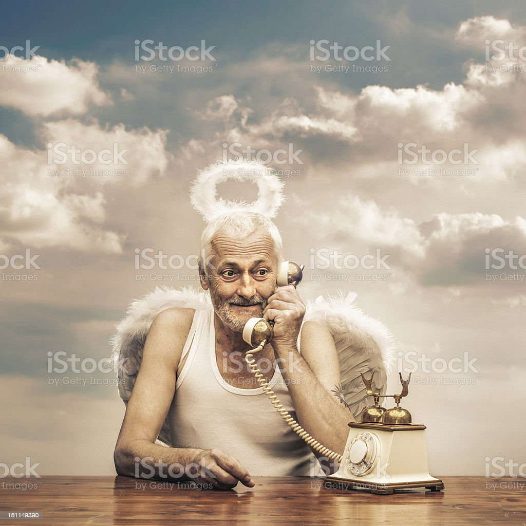 senior angel holding telephone receiver stock photo