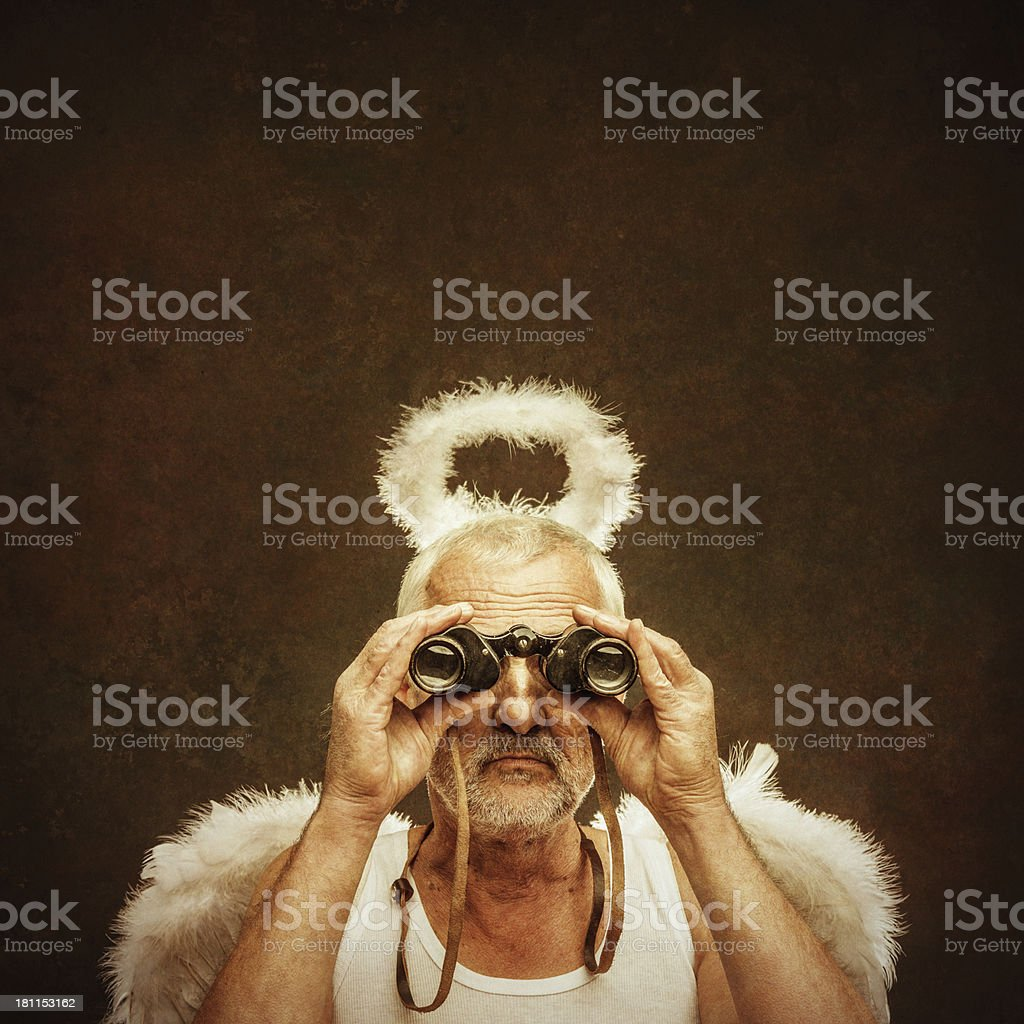 senior angel using binocular stock photo