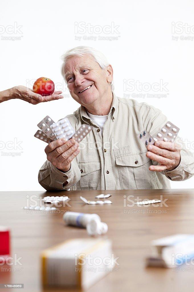 senior apple or pills royalty-free stock photo