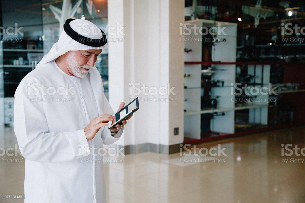 Senior Arabian Man with cellphone stock photo