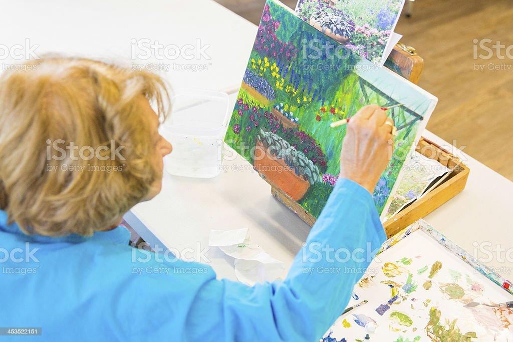 Senior Artist painting stock photo