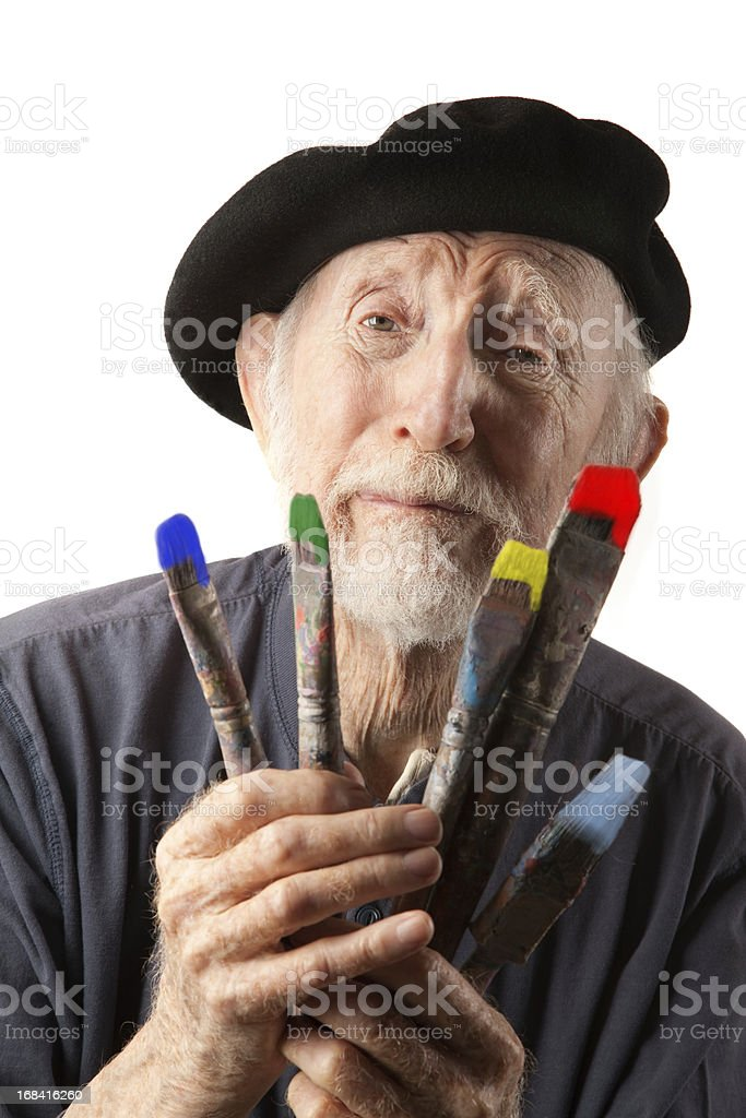 Senior artist with beret and brushes royalty-free stock photo