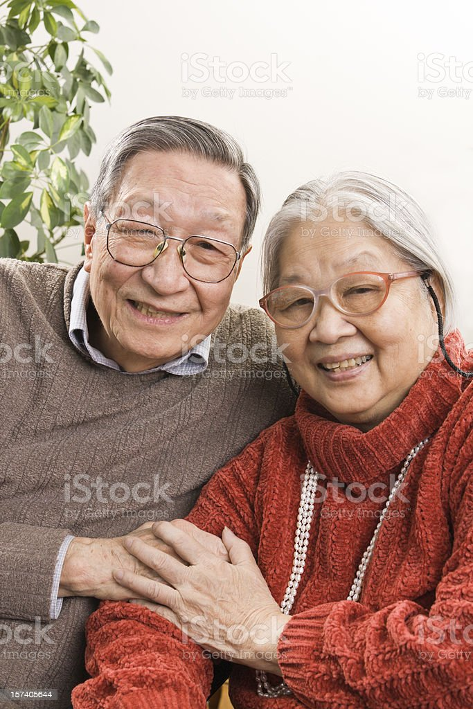 Senior Asian Couple, Retired Chinese Grandparents Happy Together at Home royalty-free stock photo