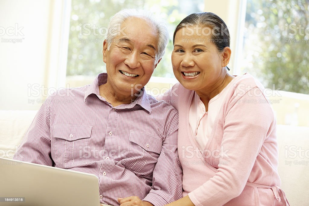 Senior Asian couple using laptop royalty-free stock photo