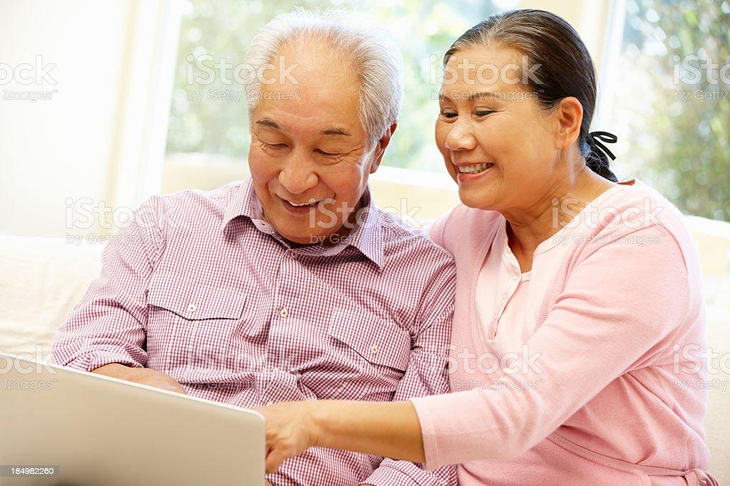 Senior Asian couple using laptop royalty-free stock photo