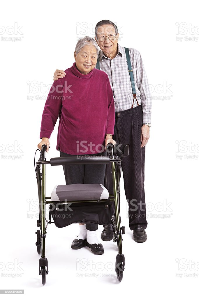 Senior Asian Couple Using Orthopedic Walker for Physical Therapy Exercise royalty-free stock photo
