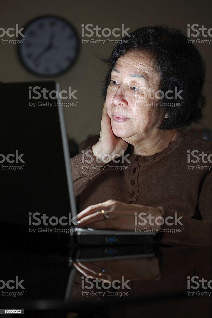 senior asian lady working late royalty-free stock photo