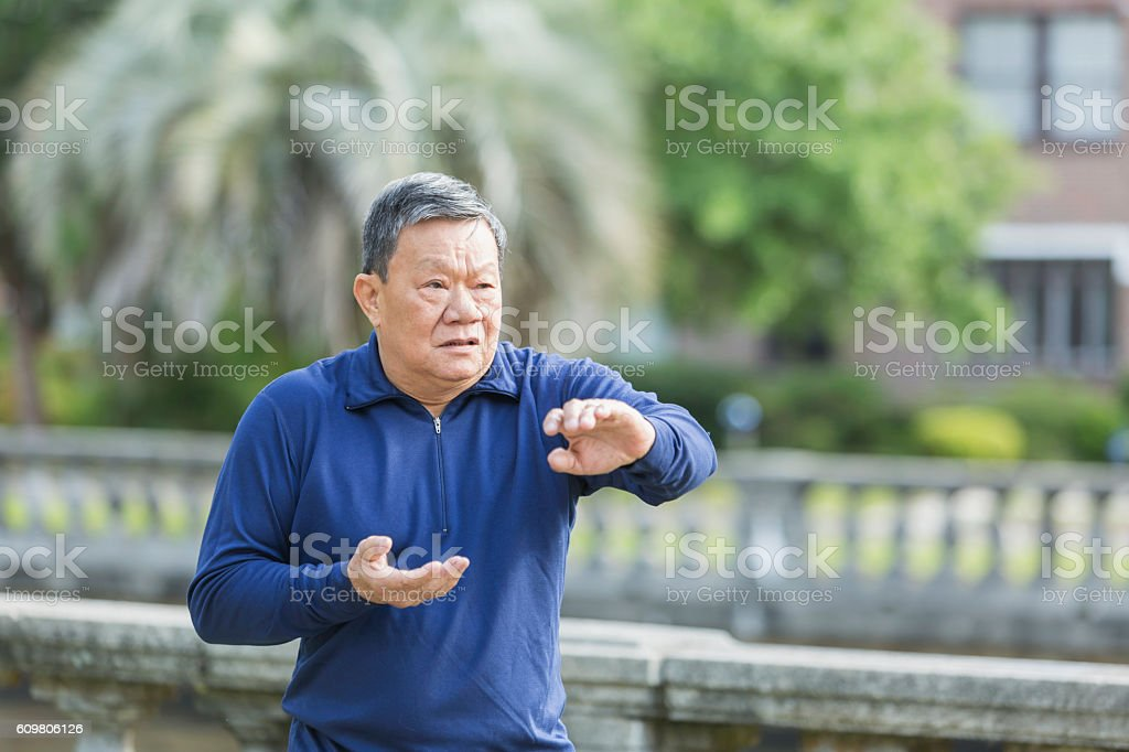 Senior Asian man doing tai chi stock photo