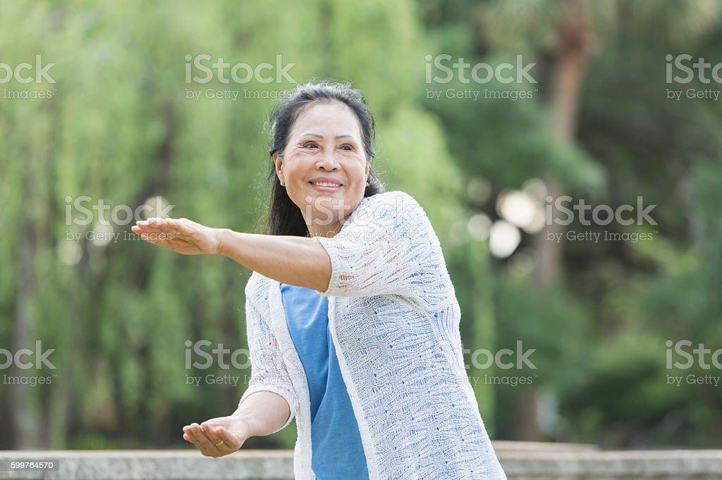 Senior Asian woman doing tai chi stock photo
