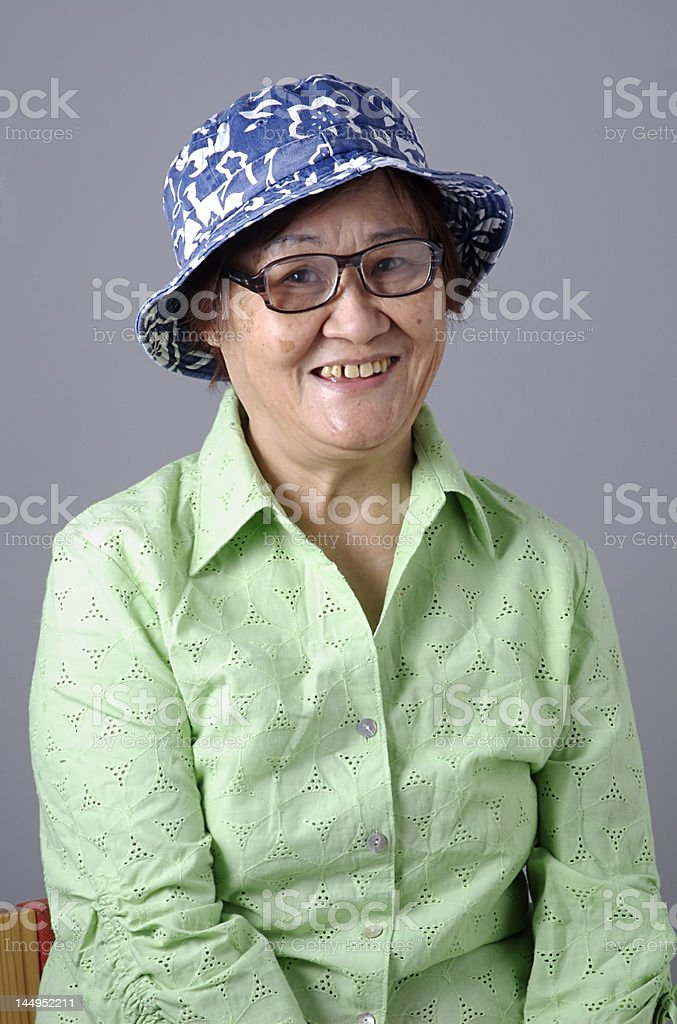 Senior Asian Woman with hat, glass and a happy face stock photo