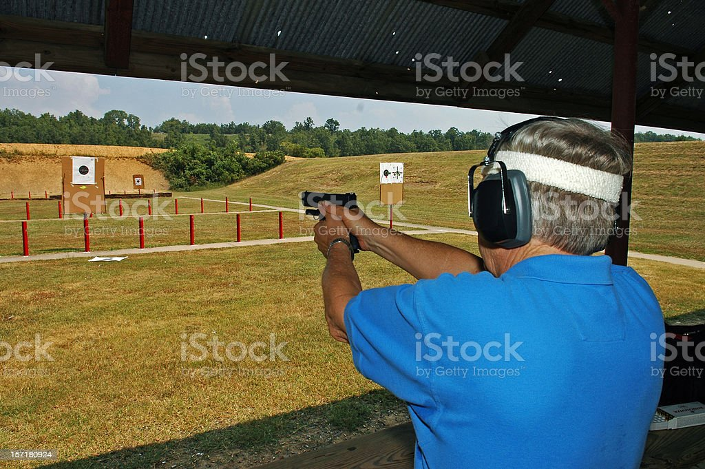 Senior at Pistol Range royalty-free stock photo