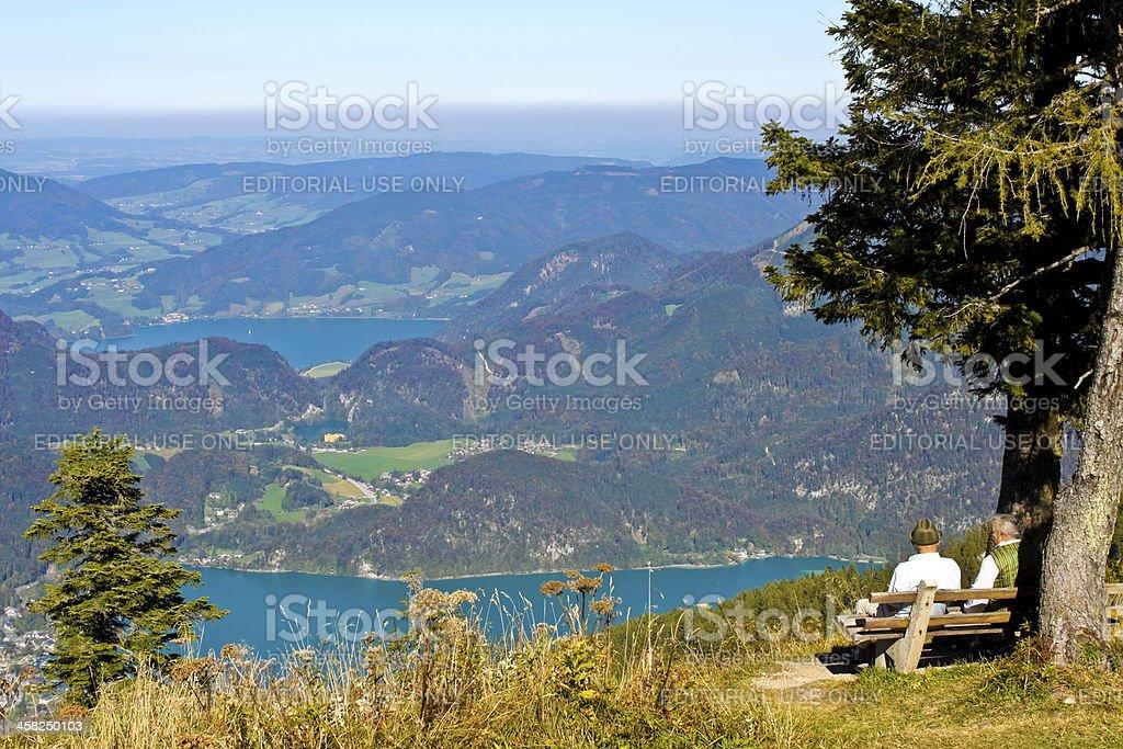 senior austrian couple looking at mountain view stock photo