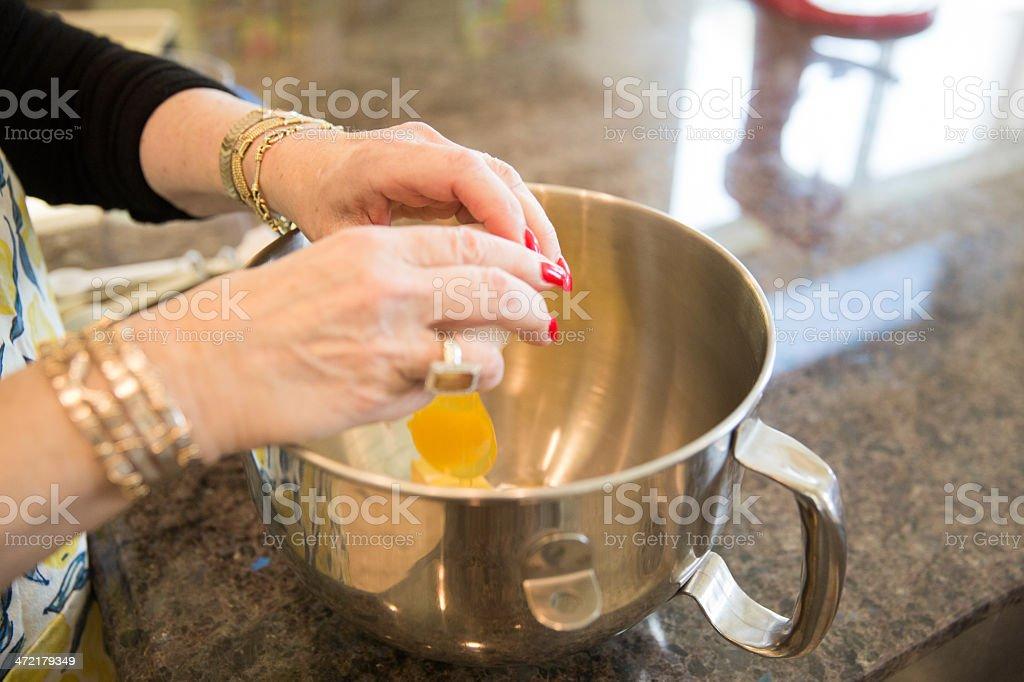 Senior Baking series-adding the eggs royalty-free stock photo