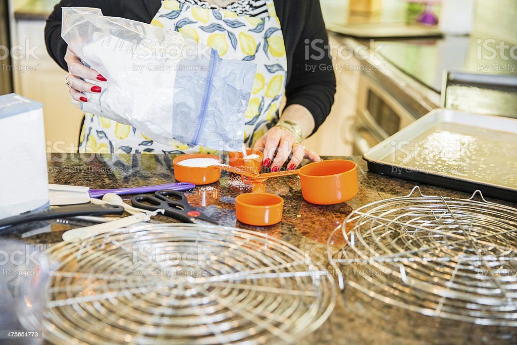 Senior Baking series-adding the sugar royalty-free stock photo
